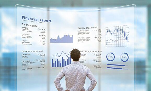 man looking at financial statement report NicoElNino AdobeStock