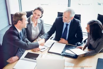 business people at a table agreeing on an exit strategy