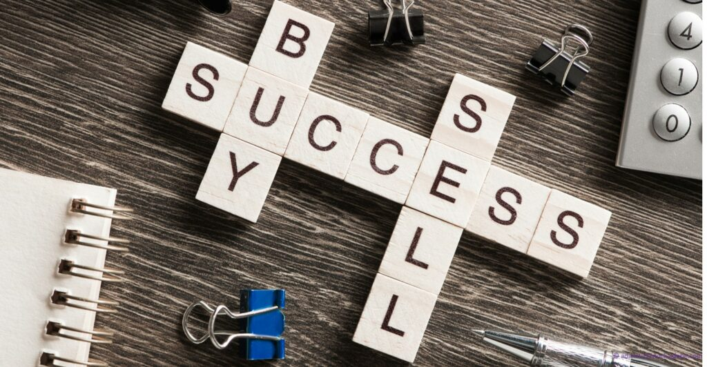 scrabble board that says buy success sell