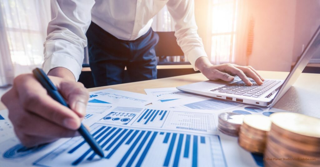 Businessman or financial expert analyze business report graph and finance chart