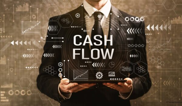 business man holding a tablet with cash flow projections
