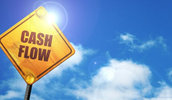 Cash flow sign in a bright blue sky