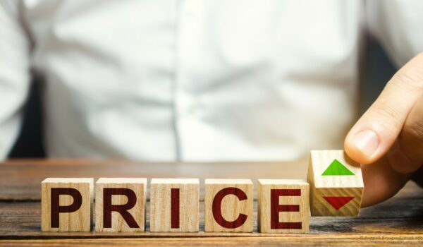 business man deciding to raise or lower prices