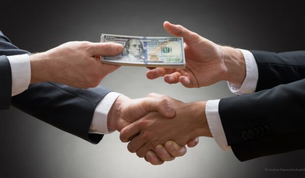 business professionals shaking hands on a loan