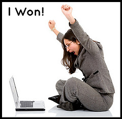 Woman Looking At Laptop With Success
